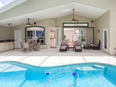 You'll love the lanai, plenty of seting for everyone! - It occupies the length of the house, with a sparkling pool big enough for lap swimmers, a party of splashing youngsters, or a rousing game of Sharks and Minnows!
