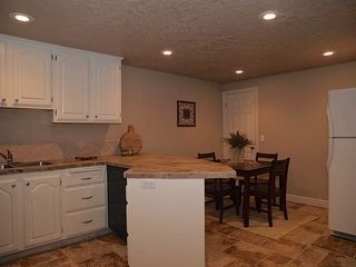 Salt Lake City house photo - BASEMENT KITCHEN (DISHWASHER, BAR, STONE FLOORS, FRIDGE)