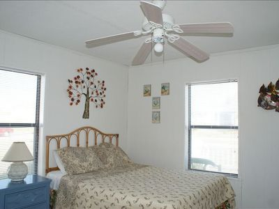 queen room with sunny windows and own ipod dock, flat screen,DVD