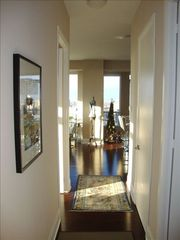 Toronto condo photo - Hallway leading both bedroom-Living/Dining/Kitchen