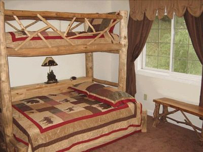 The custom built bunk bedroom with full size on bottom and twin on top