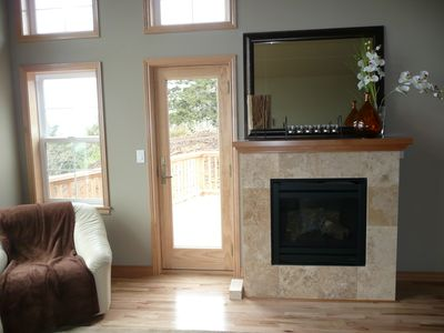 Upper Great Room, fireplace, door to Upper Deck with Grill