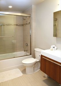 Guest bathroom has tub and shower combination