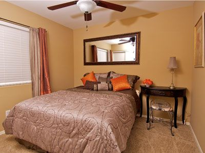 2nd Bedroom has a vanity area, ceiling fan and comfortable Queen size bed.