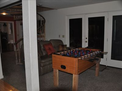Foosball for hours of fun, laundry room, workout area behind. Leads out to deck.