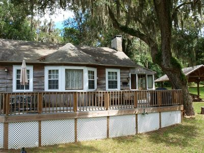 Cypress Cottage with spacious front deck and lighted picnic pavilion on right.
