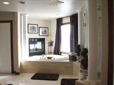Relax in the master's two person jacuzzi tub by the double-sided fire place.