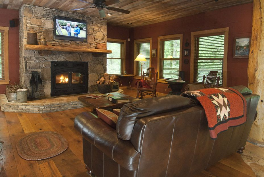 Enjoy the Warmth and Comfort of the Living Room surrounded by reclaimed barnwood