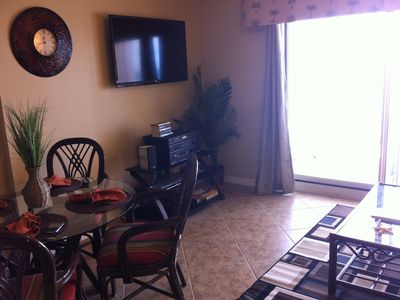 Living Room View with Brand new 46' Flat Screen TV. Brand New Tiles!