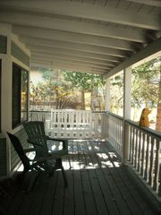 Big Bear Lake house photo - Front Covered entry - porch swing - towering pine trees