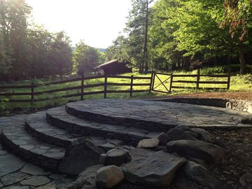 Sunset over the land and the round stone patio