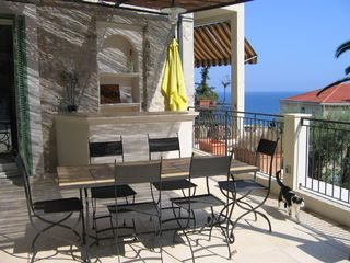 Menton villa photo - Covered outdoor dining and bar