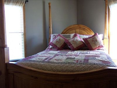 Curl up in the four-poster queen bed with rosebud quilt