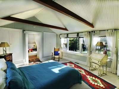 Queen bedroom with exposed beams, sunny space with 3 huge cedar closets