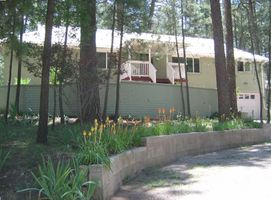 Extra Large Ruidoso Vacation Home with landscaped terrace and lawn