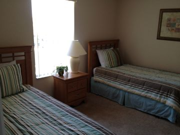 Bedroom number 4 with flat screen TV and twin beds.