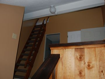Upstairs foyer with captains ladder to loft
