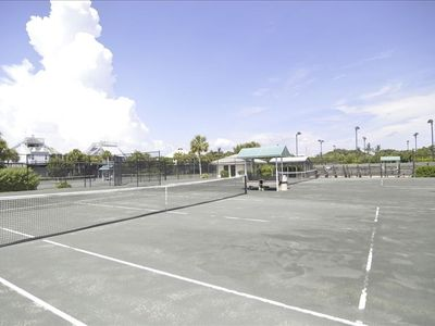 Clay tennis courts are available both day and night for pros and amateurs alike.