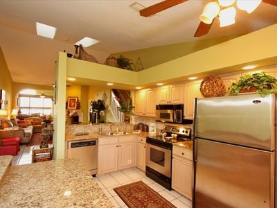 Modern Kitchen With Granite Counters & Stainless Appliances