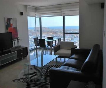 Luxury one bedroom Beach Apartment See View Above Marina