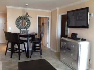 "Galveston condo photo - Dining room and media center with 42"" plasma tv, Blu-ray dvd player, iPod dock."
