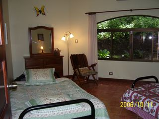 Playa Hermosa house photo - Large guest bedroom with two full-size futons and TV. Great room for the kids.