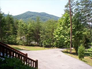 Left side mountain view also visible from game room - Pigeon Forge cabin vacation rental photo