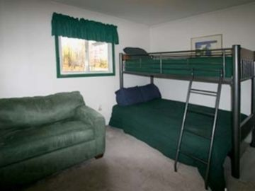 Full bed on bottom bunk and pull out couch