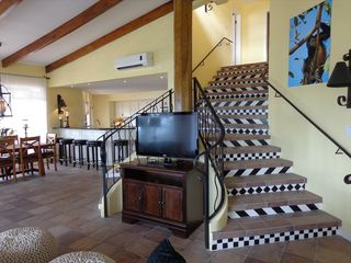 Playa Flamingo house photo - Stairway to upper level with three bedrooms