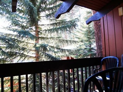 Large outdoor deck with seating and barbeque | Mammoth condo