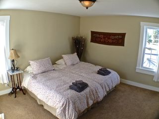 Lake Bomoseen estate photo - The Zen bedroom set w/ a King bed, has 3 bright windows w/ views of the property