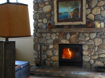 Mammoth Lakes condo rental - Living room has cozy wood-burning fireplace and lots of natural light.
