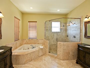 Master bath with dual vanities, 2 person jacuzzi tub & shower w/ two showerheads
