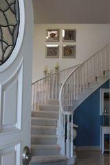 Half Moon Bay estate photo - Walking in the front door, staircase