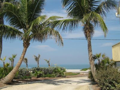 Coconut palms at the entrance lead to the beach