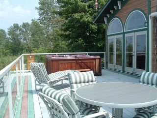 Michigan City house photo - Deck with 8 person hot tub and outside shower