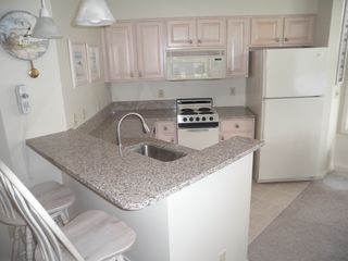 "Manistee condo photo - ""Granite"" kitchen and snack bar"
