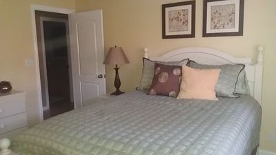 Guest bedroom w/ queen bed. Large closet too.