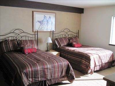 Spacious bedroom with two double beds