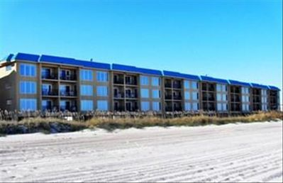 This beautiful Oceans of Amelia oceanfront condo sits right on the beach.