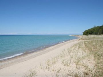 Leland house rental - Private Lake Michigan Beach guaranteed to provide a Petoskey Stone souvenir!