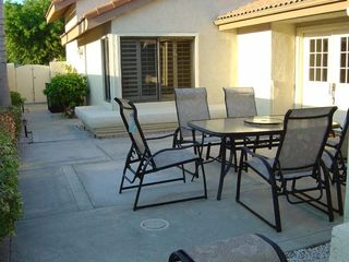 Private courtyard with patio table and gas grill - Palm Desert condo vacation rental photo