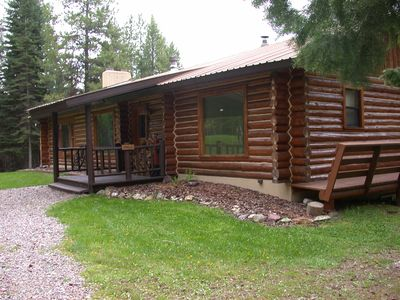 As you arrive at the Elk Antler Cabin, a log house with 3000 sq ft of space.