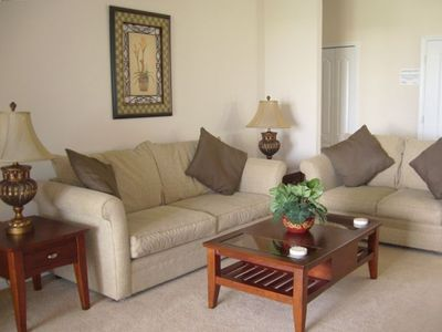 Relax in the living room area, wathc TV, play games or watch a DVD.