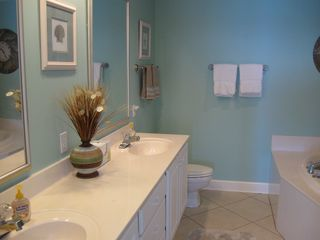 Orange Beach condo photo - Master Bath with Dual Sinks, Jacuzzi Tub and Huge Shower to Right!