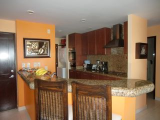 Nuevo Vallarta condo photo - Kitchen with granite counter tops and back splash. Stainless still appliances.