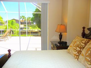 Cape Coral house photo - Guest room with sliding door access to pool, lanai and more water views