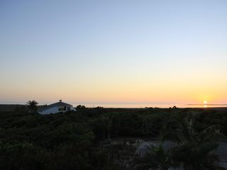 Long Island house photo - A tranquil sunset over the Caribbean side, and the Sunset Residence
