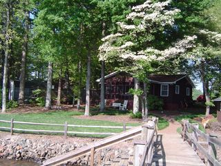 Lake Norman cottage photo - Waterfront side of house and shady fenced yard