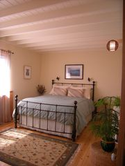 Point Reyes Station cottage photo - Downstairs bedroom with queen bed overlooks the Bay